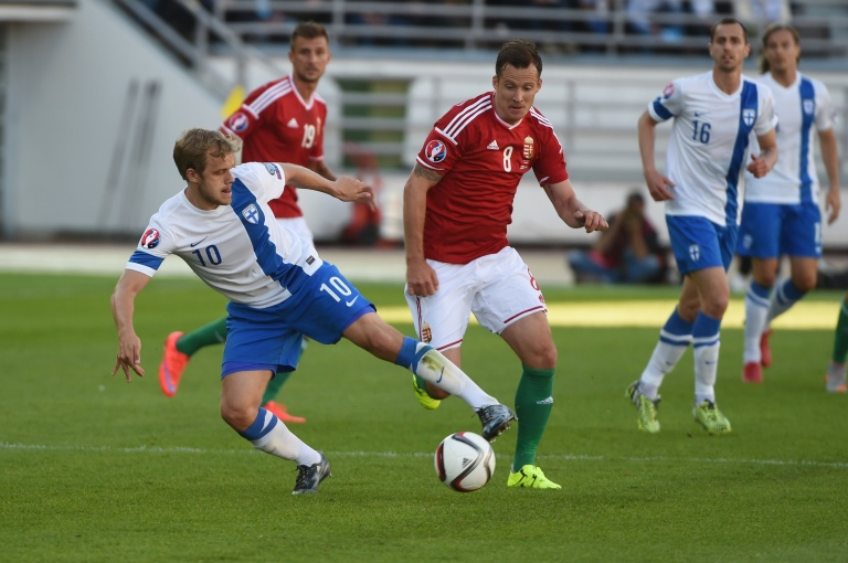 Teemu Pukki of Finland (L) and Daniel Tozser of Hungary vie for the ball during the UEFA Euro 2016 Group F qualifying football match Finland vs Hungary at the Helsinki Olympic Stadium on June 13, 2015. AFP PHOTO / LEHTIKUVA / JUSSI NUKARI   +++ FINLAND OUT +++